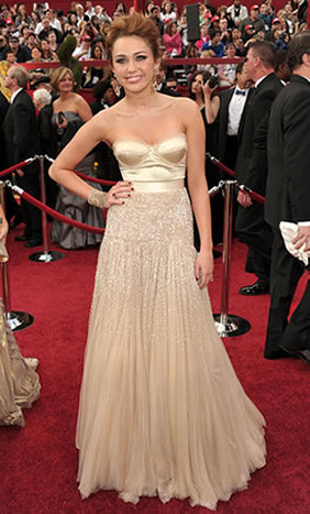 Miley Cyrus wore a golden corset with a champagne colored tulle skirt that